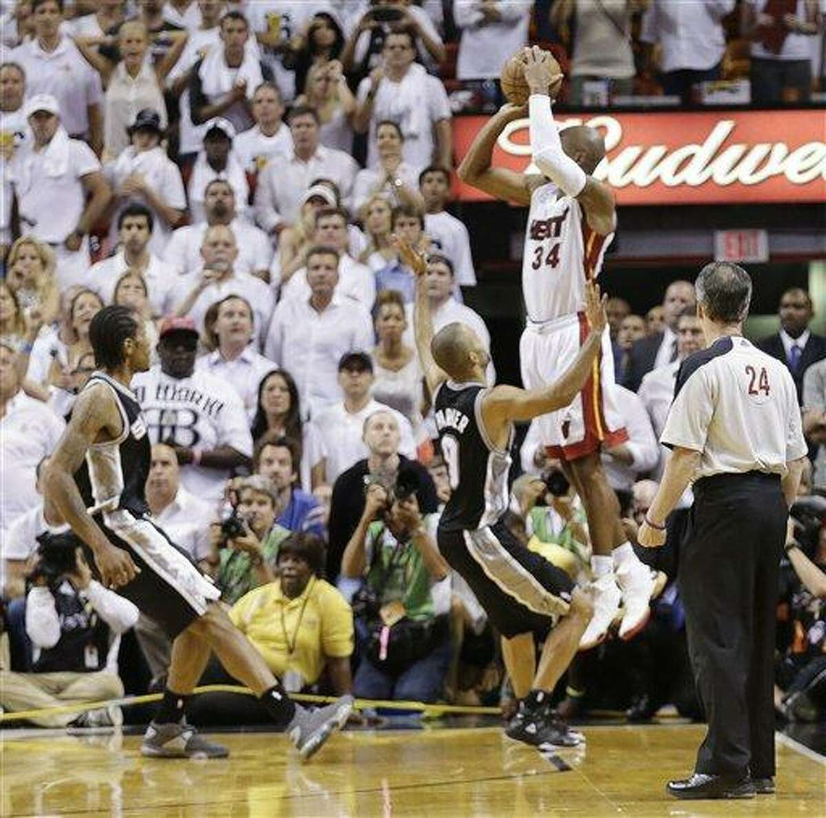 Miami Heat shooting guard Ray Allen (34) shoots a three-point basket in the end of regulation during the second half of Game 6 of the NBA Finals basketball game against the San Antonio Spurs, Wednesday, June 19, 2013 in Miami. (AP Photo/Lynne Sladky)