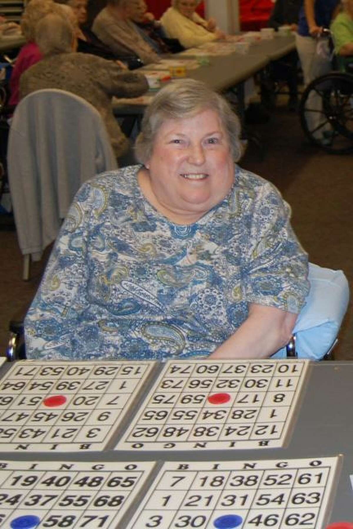 Photo Courtesy Faxton St. Luke's Carol Chrabas, a resident at St. Luke's Home, plays bingo hosted by the Kiwanis Club.