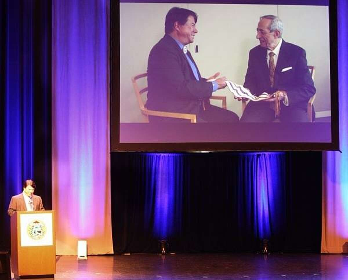 PHOTO BY JOHN HAEGER @ ONEIDAPHOTO ON TWITTER/ONEIDA DAILY DISPATCH Nation Representative and CEO of Oneida Nation Enterprises Ray Halbritter talks about the success of the gaming compact as a video is shown of him and former Governor Mario Cuomo on the 20th anniversary on Tuesday, April 16, 2013.