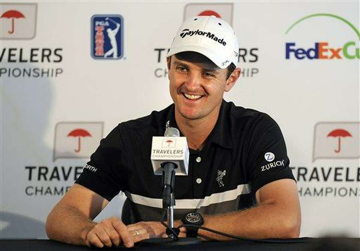 Justin Rose, of England, winner of the 2013 U.S. Open, reacts during a press conference at the Travelers Championship golf tournament in Cromwell, Conn., Wednesday, June 19, 2013. (AP Photo/Fred Beckham)