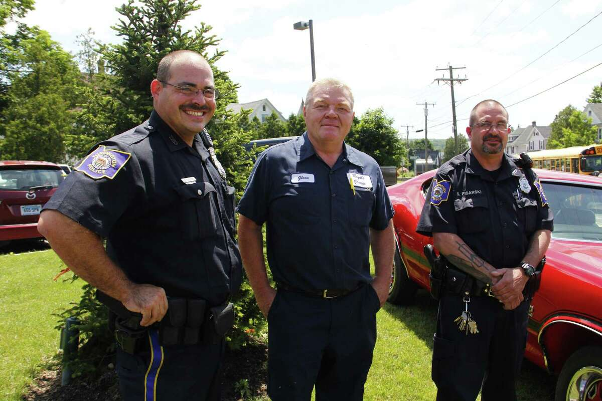 From left: Officer Steven Cloutier, Glenn Royals and officer Steve Pisarski stand outside the Torrington Police Department on Wednesday, June 19, 2013. The three men are helping organize the Torrington Police Department Auto Show, which will take place on Friday starting at 5:30 p.m. on Main Street in Downtown. More than 300 cars are expected. Esteban L. Hernandez Register Citizen