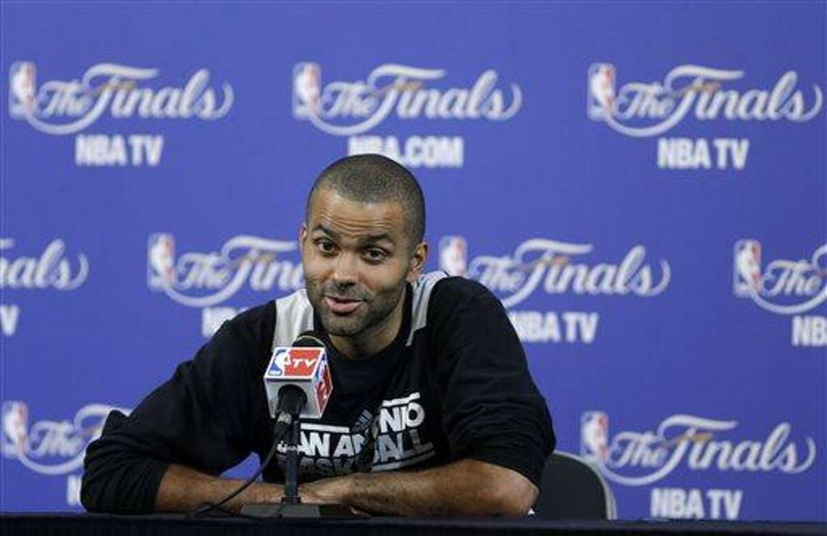 San Antonio Spurs point guard Tony Parker, of France, speaks to members of the media during a news conference after NBA basketball practice, Wednesday, June 19, 2013, at the American Airlines Arena in Miami. The Spurs take on the Miami Heat in Game 7 of the NBA Finals on Thursday in Miami. (AP Photo/Wilfredo Lee)