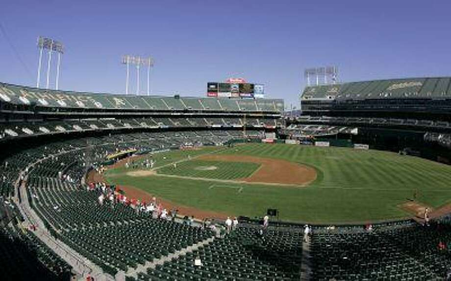 """This Sept. 30, 2007 file photo shows <a href=""""http://O.Co"""">O.Co</a> Coliseum, then called McAfee Coliseum, home of the Oakland Athletics baseball team, in Oakland, Calif. Photo: AP / AP"""