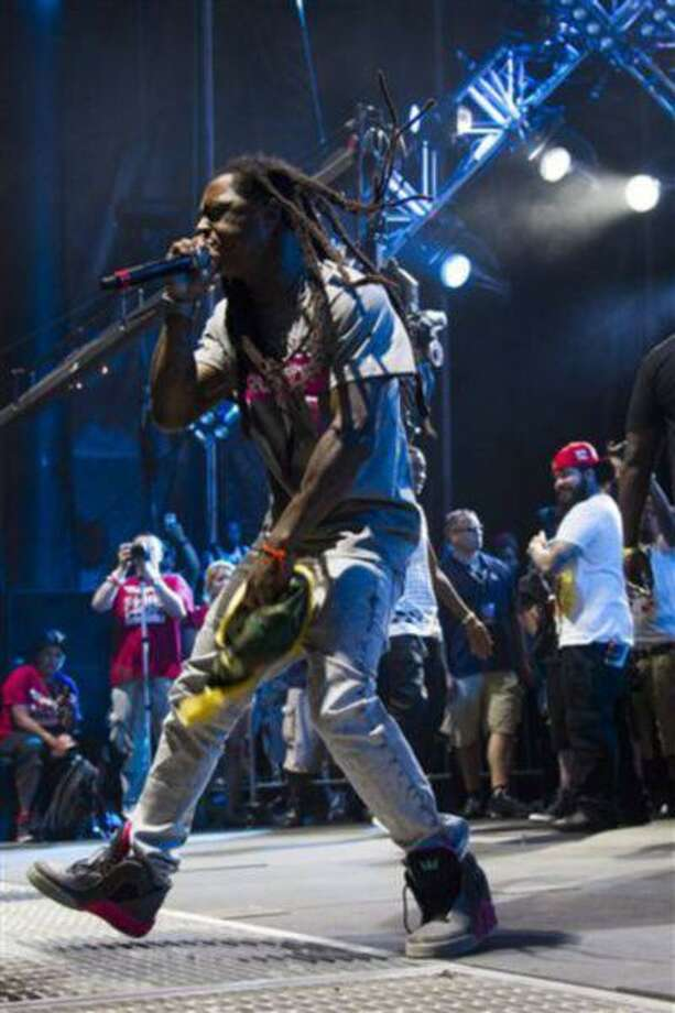 Lil Wayne performs at the Hot 97 Summer Jam XX on Sunday, June 2, 2013 in East Rutherford, N.J. (Photo by Charles Sykes/Invision/AP) Photo: Charles Sykes/Invision/AP / Invision