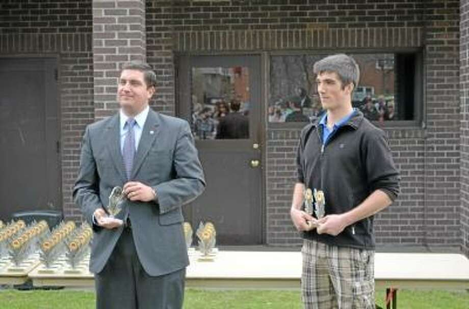Kate Hartman/Register Citizen. Mayor Ryan Bingham and Nick Lamoth, vice president of the Mayor's Committee on Youth, distributed the awards for at the annual Youth Services awards day at Coe Memorial Park.