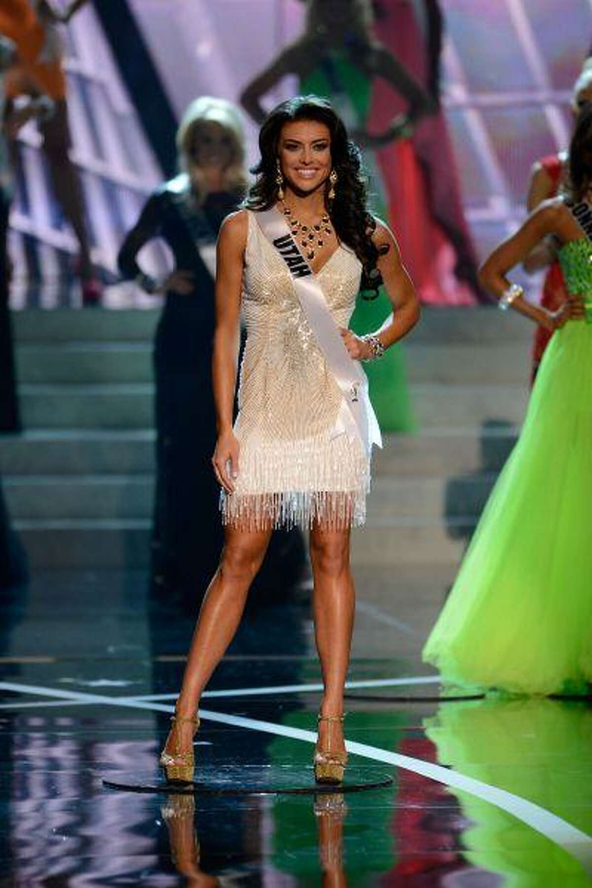 Miss Utah Marissa Powell walks onstage during the Miss USA 2013 pageant, Sunday, June 16, 2013, in Las Vegas. (AP Photo/Jeff Bottari)