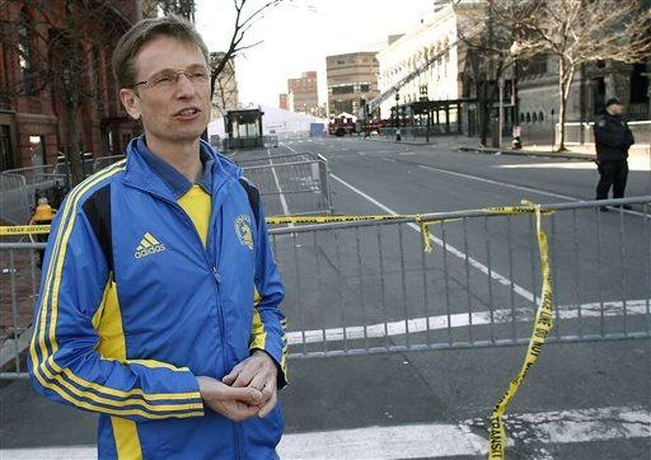 Near the Boston Marathon finish line, first-time Boston Marathoner Michael Terhorst of Germany talks about crossing the finish line minutes before the explosions in Boston Tuesday, April 16, 2013.  Investigators appealed to the public Tuesday for amateur video and photos that might yield clues to the Boston Marathon bombing. (AP Photo/Winslow Townson) Photo: ASSOCIATED PRESS / AP2012