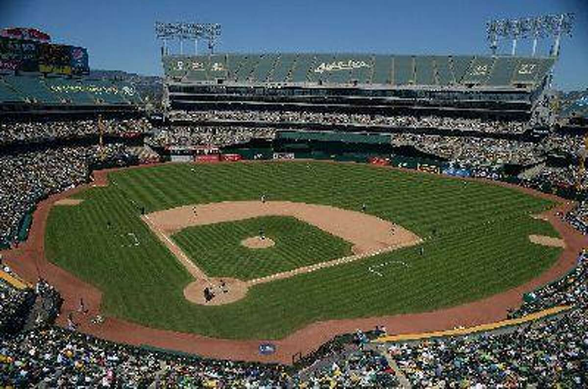 The Oakland Athletics play the Seattle Mariners in the fifth inning of their game at O.co Coliseum in Oakland, Calif., on Sunday, June 16, 2013. Oakland defeated Seattle 10-2. (Jose Carlos Fajardo/Bay Area News Group)