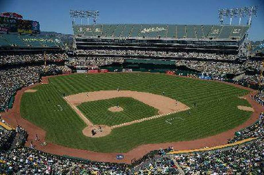 "The Oakland Athletics play the Seattle Mariners in the fifth inning of their game at <a href=""http://O.co"">O.co</a> Coliseum in Oakland, Calif., on Sunday, June 16, 2013. Oakland defeated Seattle 10-2. (Jose Carlos Fajardo/Bay Area News Group)"