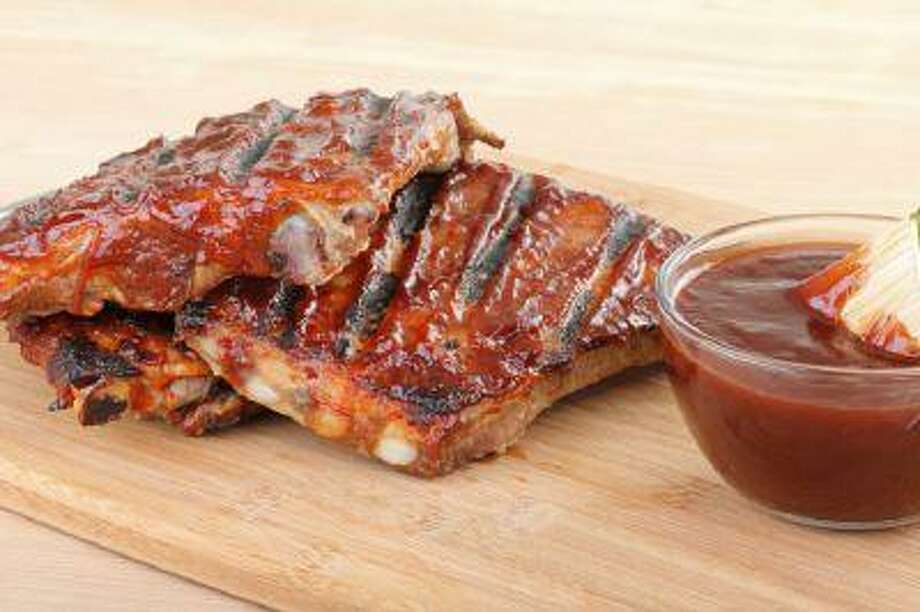 Laced with pineapple, mango, blackberries and more, a rich, fruity barbecue sauce provides plenty of flavor -- but some sauces are vastly better than others. Photo: Getty Images/iStockphoto / iStockphoto