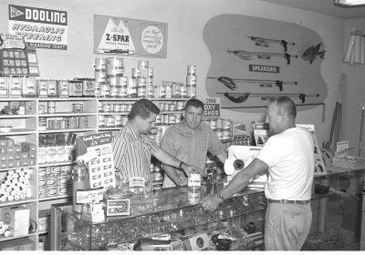 Bill Meistrell, left, and Bob Meistrell, center, work with a customer at the Dive and Surf store. (Body Glove Photo)