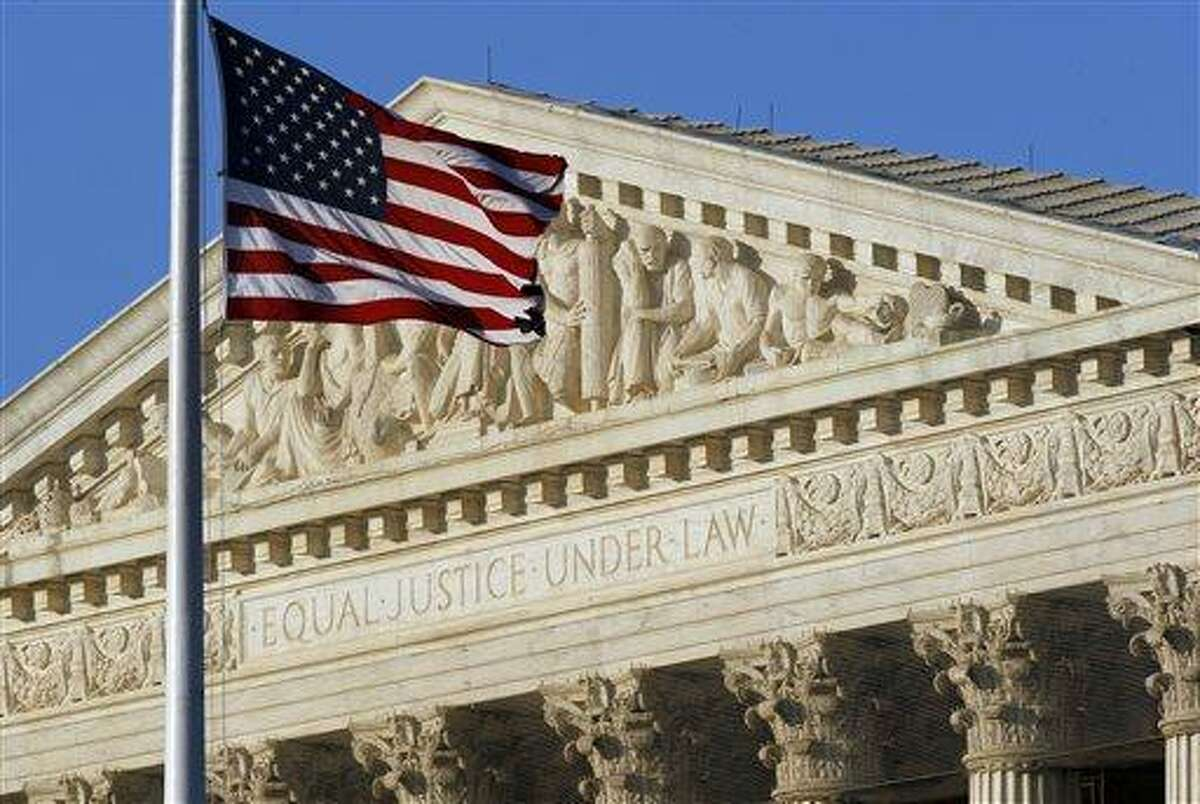 An American flag flies in front of the Supreme Court in Washington. Associated Press file photo