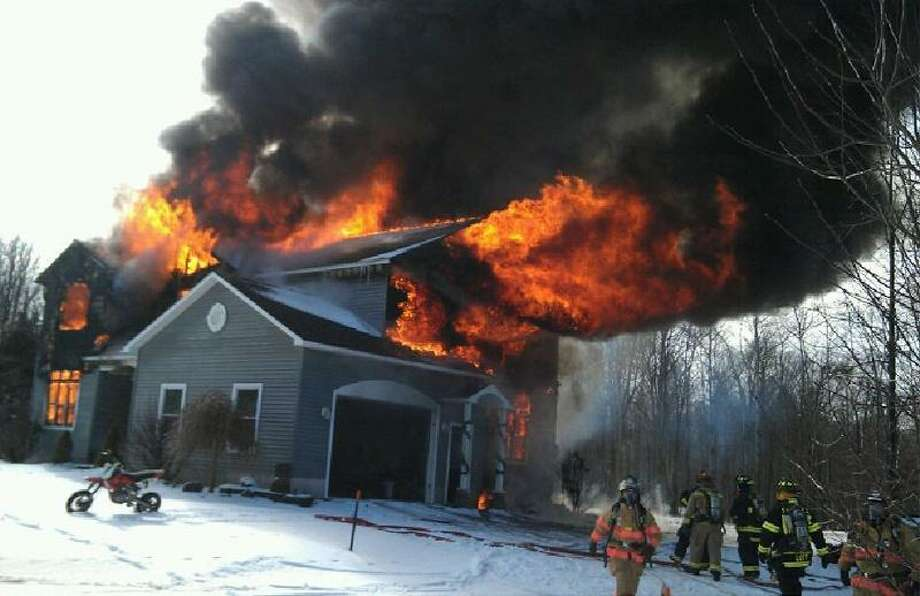 Photo Courtesy Kazlauskas Family A fire destroyed a home at 4988 Carrick Road, owned by Mike and Deanna Kazlauskas, Thursday, Feb. 7, 2013.