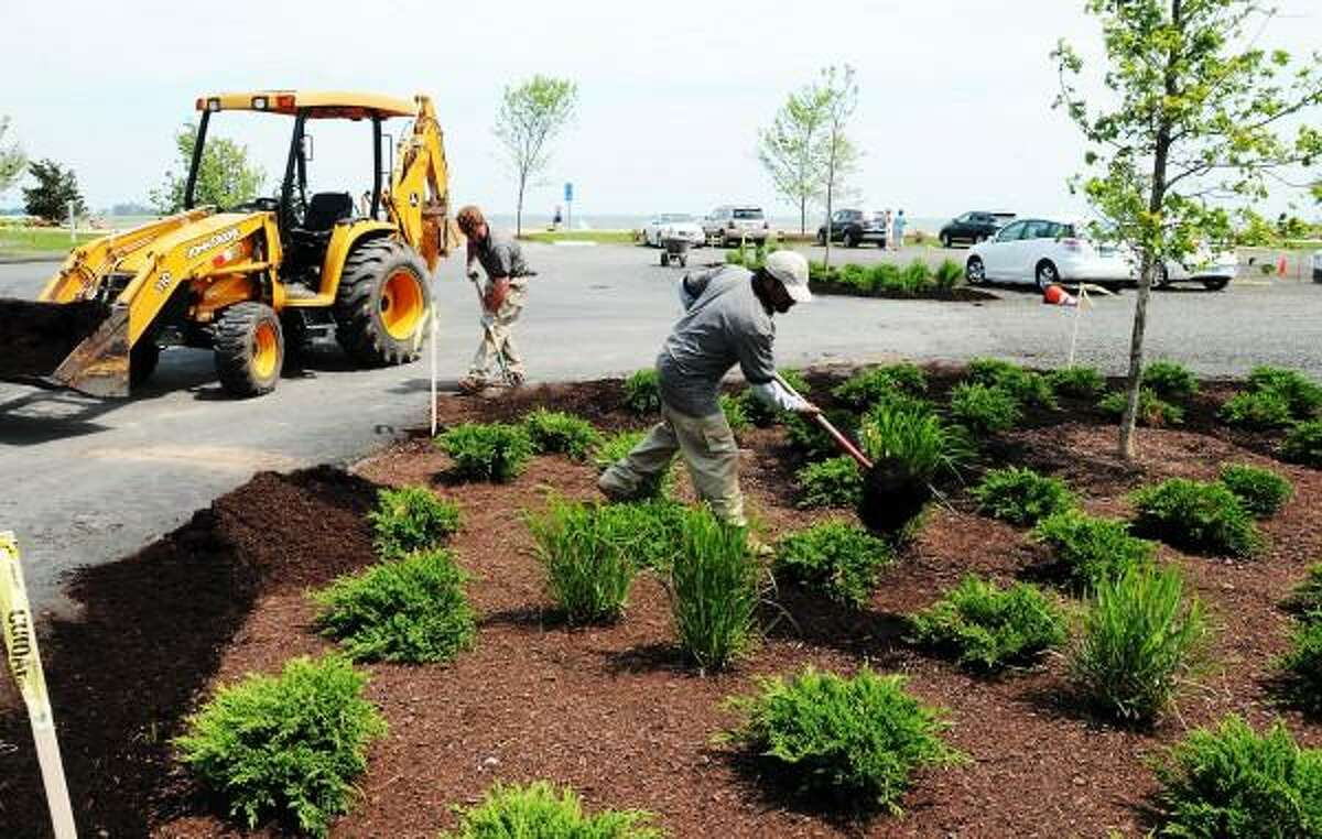 Mara Lavitt/New Haven Register June 18, 2013: Jacobs Beach in Guilford is undergoing an improvement project. Today South Gate Nurserymen of North Haven, including landscape construction supervisor Nick Zacarelli left and landscape worker Faustino Ojeda were working on the landscaping.