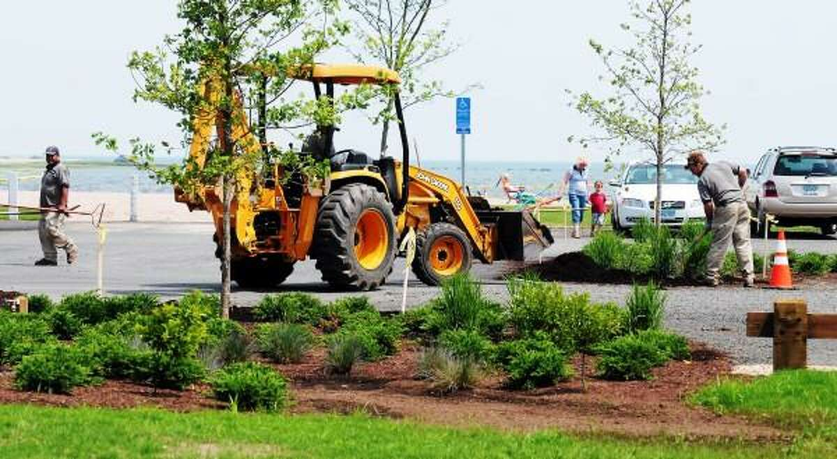 Mara Lavitt/New Haven Register June 18, 2013: Jacobs Beach in Guilford is undergoing an improvement project. Today South Gate Nurserymen of North Haven were working on the landscaping.