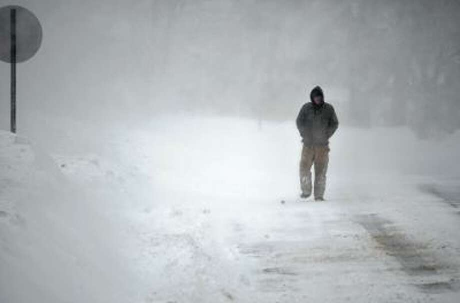 John Keenan of Terryville walks down Pearl St. in Torrington on Saturday morning. John Berry/Register Citizen