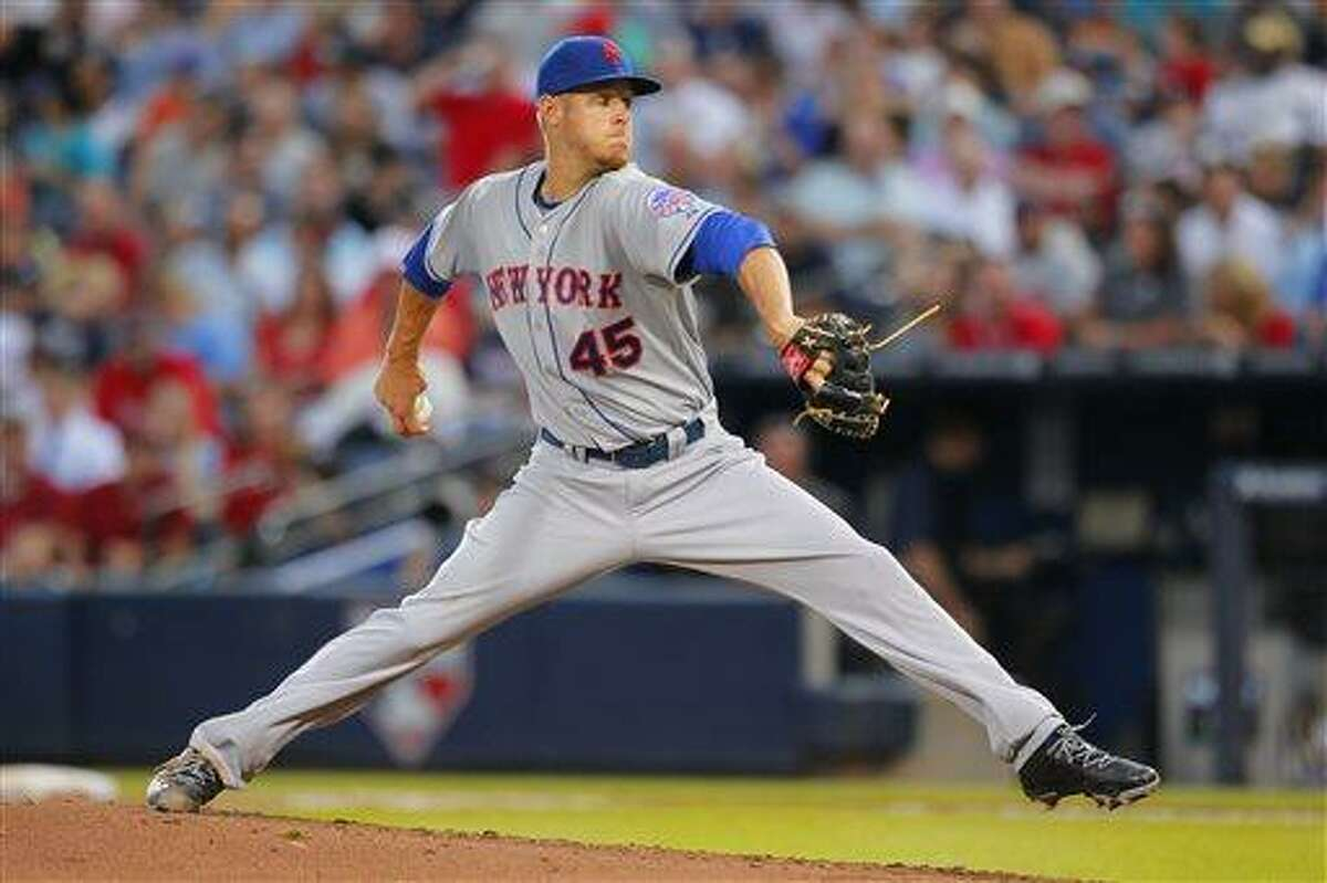 New York Mets starting pitcher Zack Wheeler pitches in the fifth inning in the second baseball game of a doubleheader against the Atlanta Braves Tuesday, June 18, 2013, in Atlanta. (AP Photo/Todd Kirkland)
