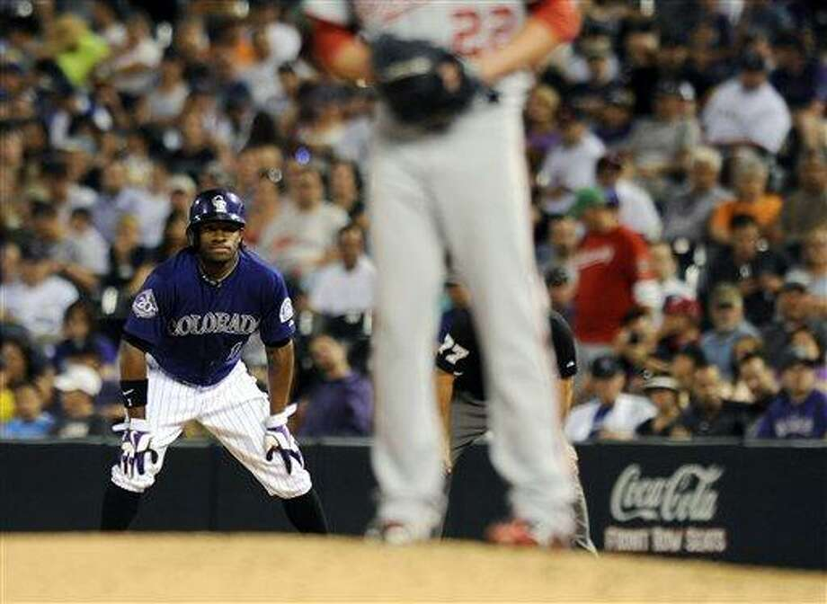 Colorado Rockies Eric Young Jr. takes a lead off first base in the eighth inning of a baseball game against the Washington Nationals on Tuesday, June 11, 2013 in Denver. The Rockies won 8-3. (AP Photo/Chris Schneider) Photo: AP / FR170036 AP