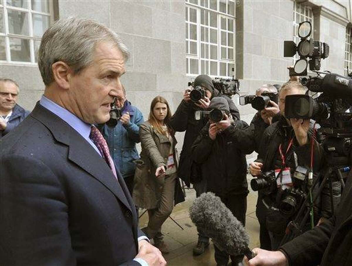 Secretary of State for Environment, Food and Rural Affairs (Defra) Owen Paterson, left, speaks to the media outside Defra Headquarters in London, Saturday Feb. 9, 2013, after an emergency meeting with the Food Standards Agency (FSA) and representatives of various leading retailers, as revelations about the widespread use of horseheat in supermarket beef products continues to hit consumer confidence. Concerns about the use of horsemeat burst into the spotlight earlier this year, after it emerged that some beef products contained horse DNA, and now the whole industry faces pressure to test their products and reveal the findings. (AP Photo / John Stillwell, PA)