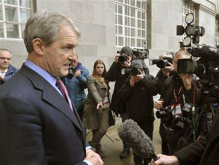 Secretary of State for Environment, Food and Rural Affairs (Defra) Owen Paterson, left, speaks to the media outside Defra Headquarters in London, Saturday Feb. 9, 2013,  after an emergency meeting with the Food Standards Agency (FSA) and representatives of various leading retailers, as revelations about the widespread use of horseheat in supermarket beef products continues to hit consumer confidence.  Concerns about the use of horsemeat burst into the spotlight earlier this year, after it emerged that some beef products contained horse DNA, and now the whole industry faces pressure to test their products and reveal the findings.  (AP Photo / John Stillwell, PA) Photo: AP / PA