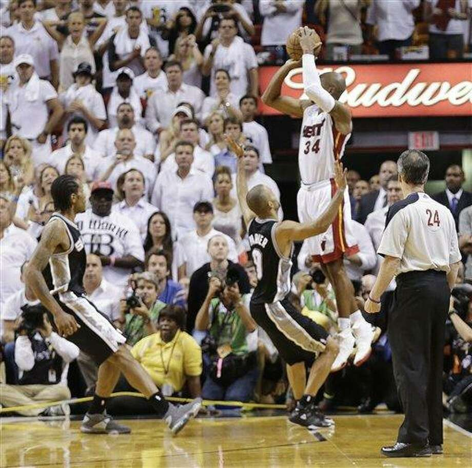 Miami Heat shooting guard Ray Allen (34) shoots a three-point basket in the end of regulation  during the second half of Game 6 of the NBA Finals basketball game against the San Antonio Spurs, Wednesday, June 19, 2013 in Miami. (AP Photo/Lynne Sladky) Photo: AP / AP