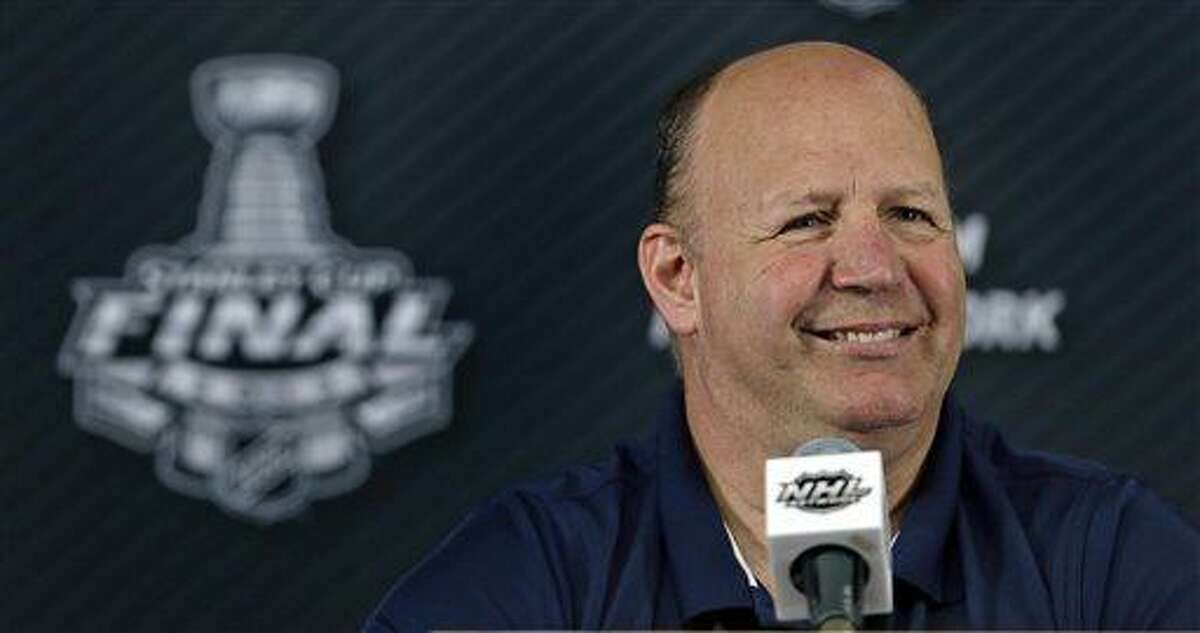 Boston Bruins head coach Claude Julien smiles as he is asked a question during a media availability after NHL hockey practice in Boston, Tuesday, June 18, 2013. The Bruins lead the Chicago Blackhawks 2-1 in the best-of-seven games series in the Stanley Cup Finals. Game 4 is scheduled for Wednesday in Boston. (AP Photo/Charles Krupa)
