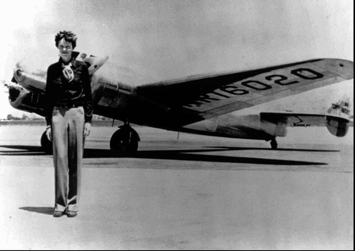 Amelia Earhart, 40, stands next to a Lockheed Electra 10E, before her last flight in 1937 from Oakland, Calif., bound for Honolulu on the first leg of her record-setting attempt to circumnavigate the world westward along the Equator. (AP Photo)