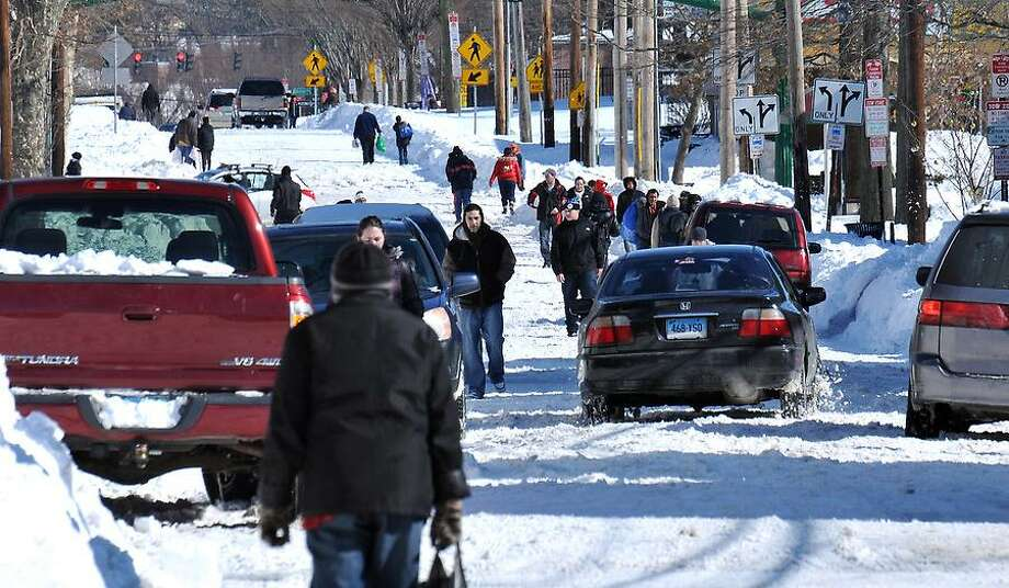 New Haven--People walk along Grand Avenue in Fair Haven.  Photo-Peter Casolino 2/10/13
