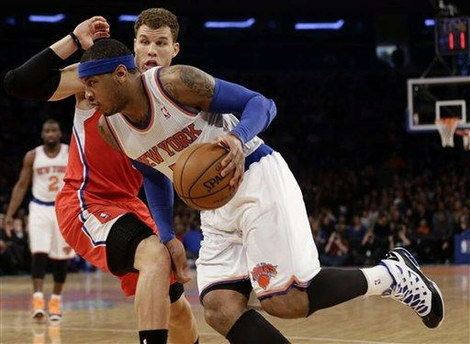 New York Knicks' Carmelo Anthony, front, drives past Los Angeles Clippers' Blake Griffin during the first half of an NBA basketball game on Sunday, Feb. 10, 2013, in New York. (AP Photo/Frank Franklin II) Photo: ASSOCIATED PRESS / AP2013