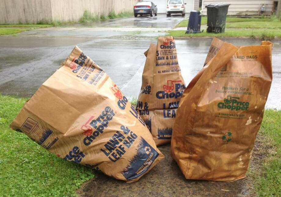 KURT WANFRIED/Oneida Daily Dispatch Some bags full of green waste await pickup by City in Oneida crews.