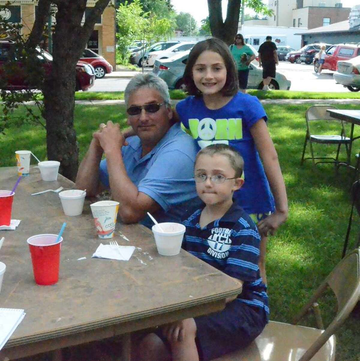 Leah McDonald/Oneida Daily Dispatch Michael Mazzullo, Alexis Mazzullo and Anthony Mazzullo at the Oneida Elks Club's annual Strawberry Festival Tuesday, June 18, 2013.