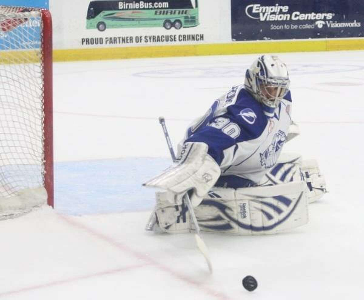 JOHN HAEGER @ONEIDAPHOTO ON TWITTER/ONEIDA DAILY DISPATCH Syracuse Crunch goalie Cedrick Desjardins (30) reaches to stop the puck in the first period.