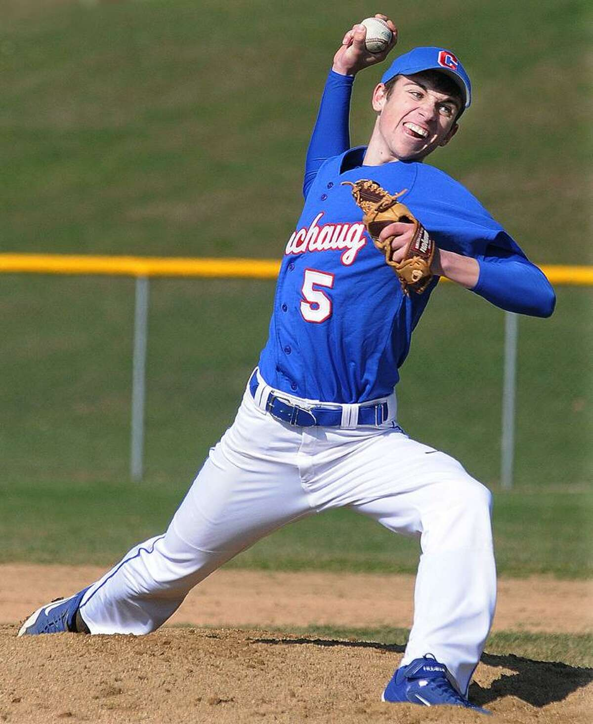 Catherine Avalone/The Middletown Press Coginchaug pitcher Mike McShane on the mound against Old Saybrook Monday afternoon at home. McShane threw 81 strikes out of 120 pitches. Coginchaug won 3-2 in a walk off in the 10th inning.