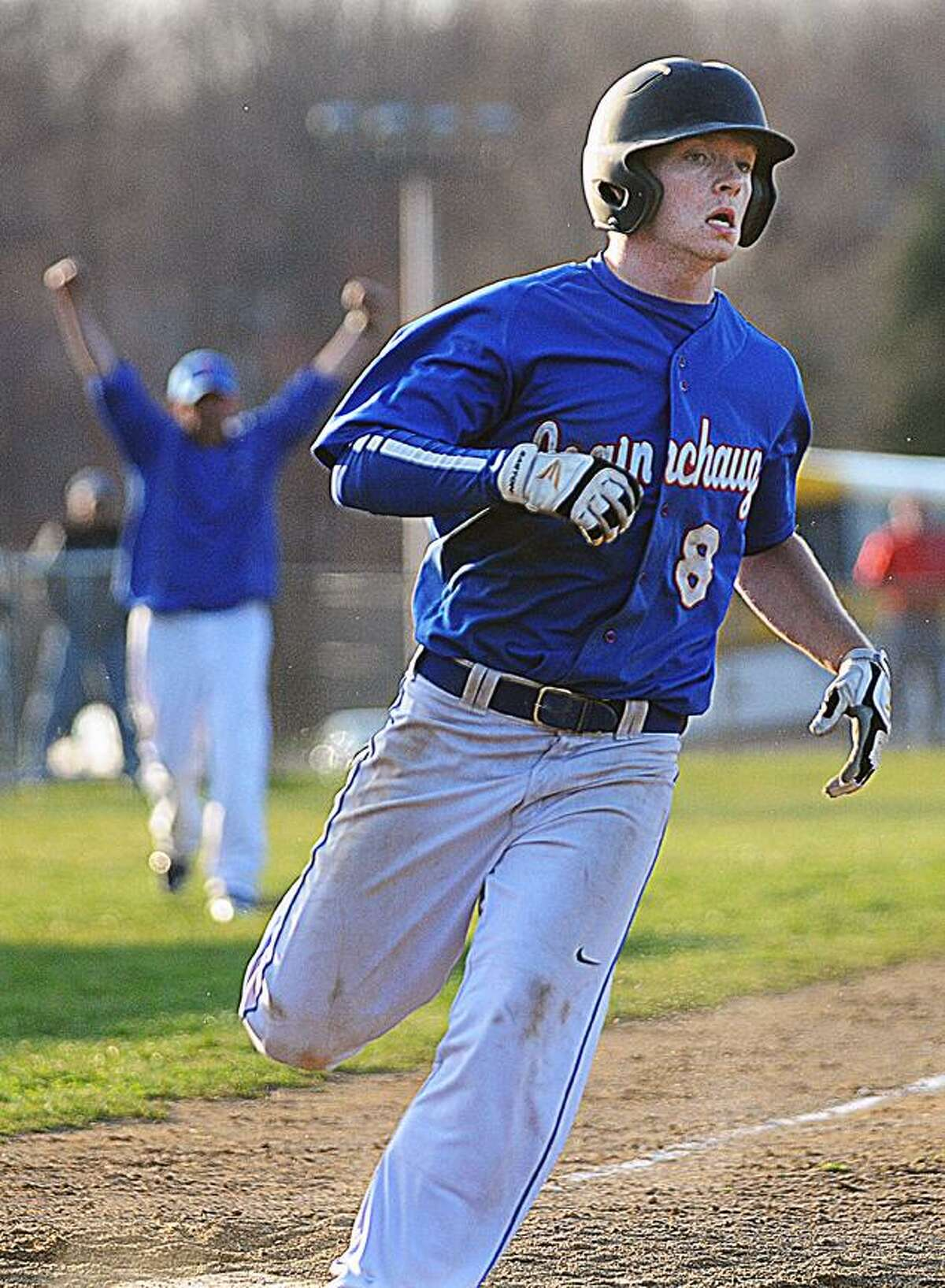Catherine Avalone/The Middletown Press Coginchaug junior center fielder Christian Adams scores the winning run against Old Saybrook in the tenth inning to win their second walk off on a Monday afternoon. The Blue Devils defeated Old Saybrook 3-2 in Durham.