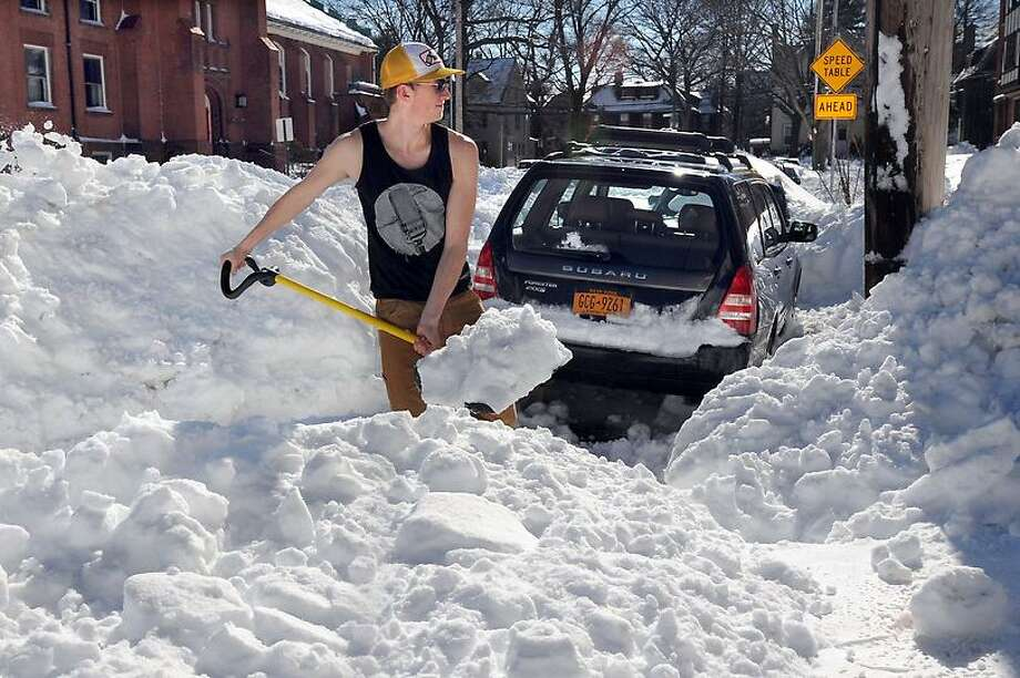 The Blizzard of 2013, Nemo. Owen Funk, a native of Fairbanks, AK, digs out his friend's car so Funk can get to his work at Yale Mara Lavitt/New Haven Register2/10/13