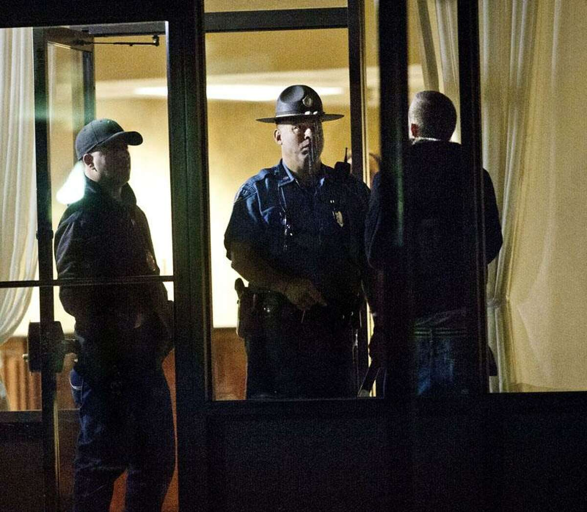 Revere-A State trooper talks to a man trying to enter the Ocean Apartments. Evidence was taken from the buildings.Melanie Stengel/Register