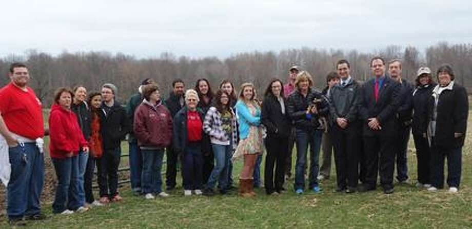 """Photo Courtesy Fred """"Fritz"""" Scherz Some of the volunteers who took part in the inaugural CNY Walk for Wounded Veterans Saturday, April 13, 2013, at The Root Farm in Verona. The event was coordinated by Rob Thrasher."""