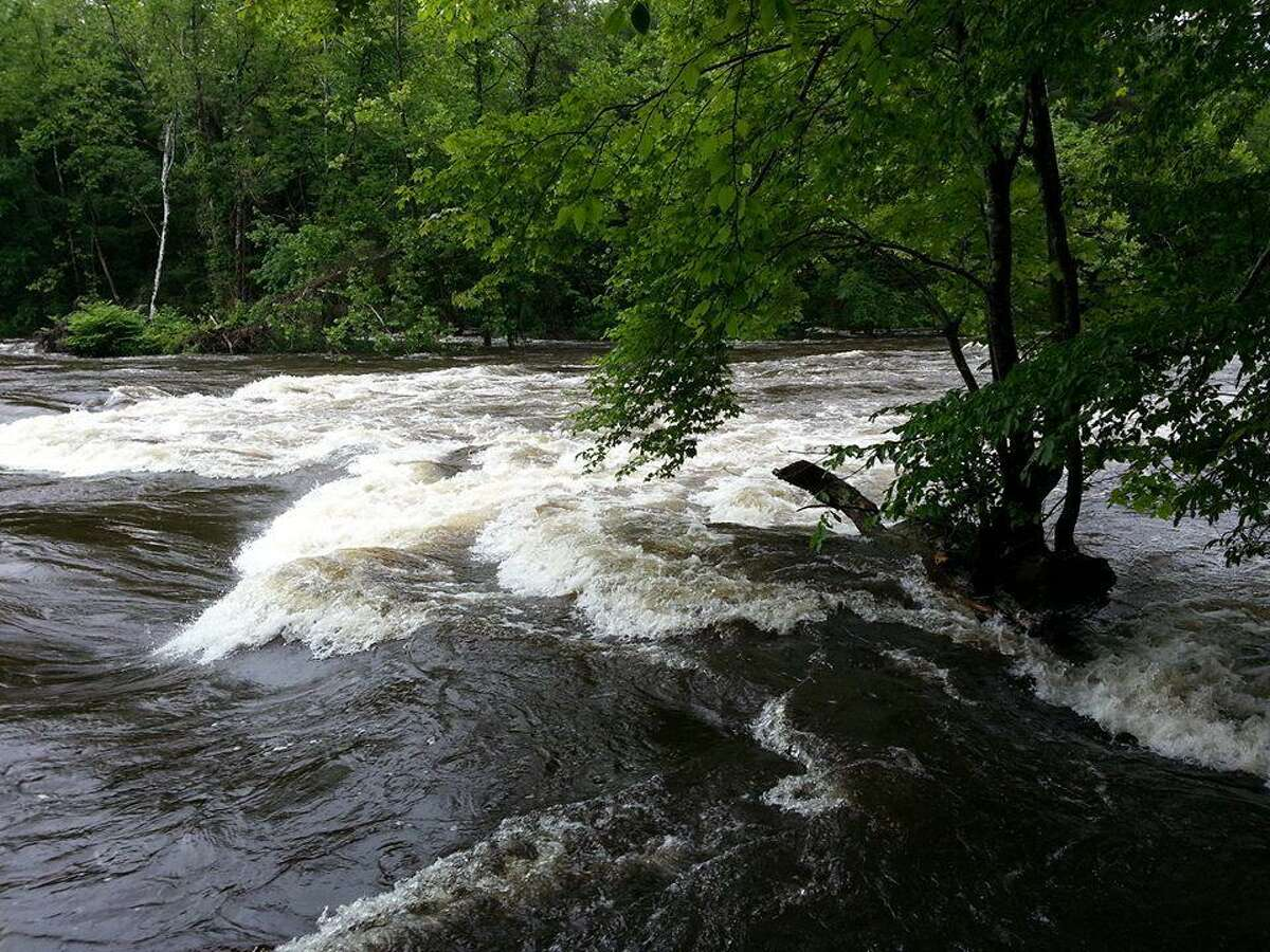 A photo uploaded to Facebook Friday by the Farmington River Tubing company, which closed its operations because of flooding,shows the river conditions near where a woman was reported missing in New Hartford after falling into the water Saturday morning. Contributed photo.