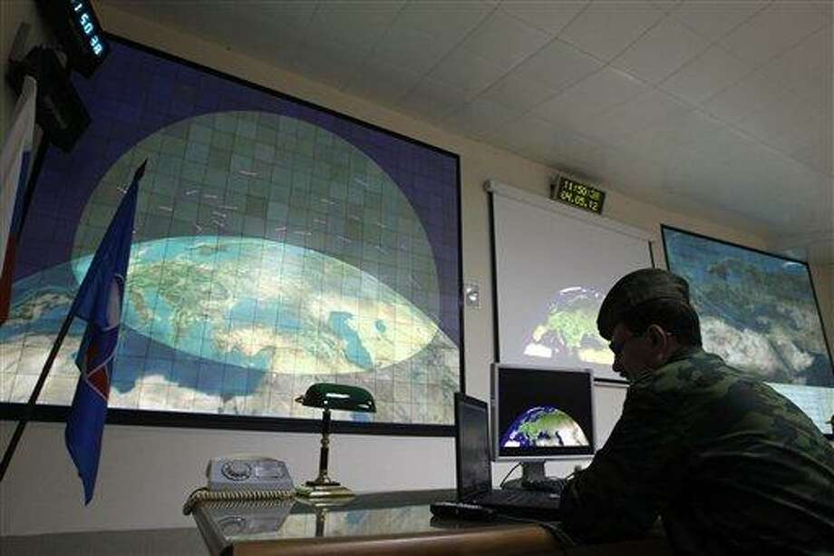 FILE - In this  Friday, May 4, 2012 file photo, a Russian military officer is on duty in the main control center of a radar station at the missile defense facility in Sofrino, 50 km (31 miles) northeast of Moscow. Secret U.S. Defense Department studies have cast doubt on whether a multibillion dollar missile defense system planned for Europe will ever be able to protect the United States from Iranian missiles as intended, congressional investigators say. (AP Photo/Mikhail Metzel, File) Photo: AP / AP