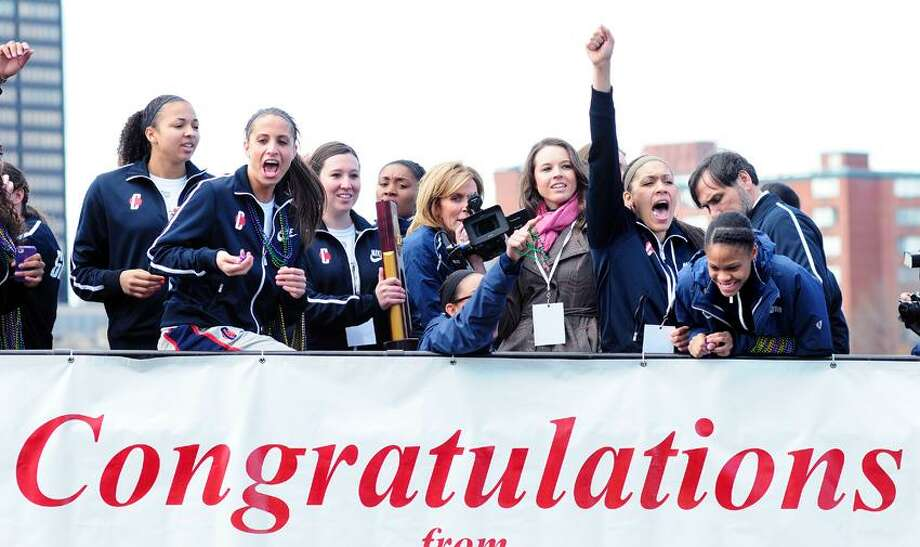 The UCONN women's 2013 NCAA championship basketball team celebrates on top of a double decker bus during a parade through downtown Hartford on 4/14/2013.Photo by Arnold Gold/New Haven Register