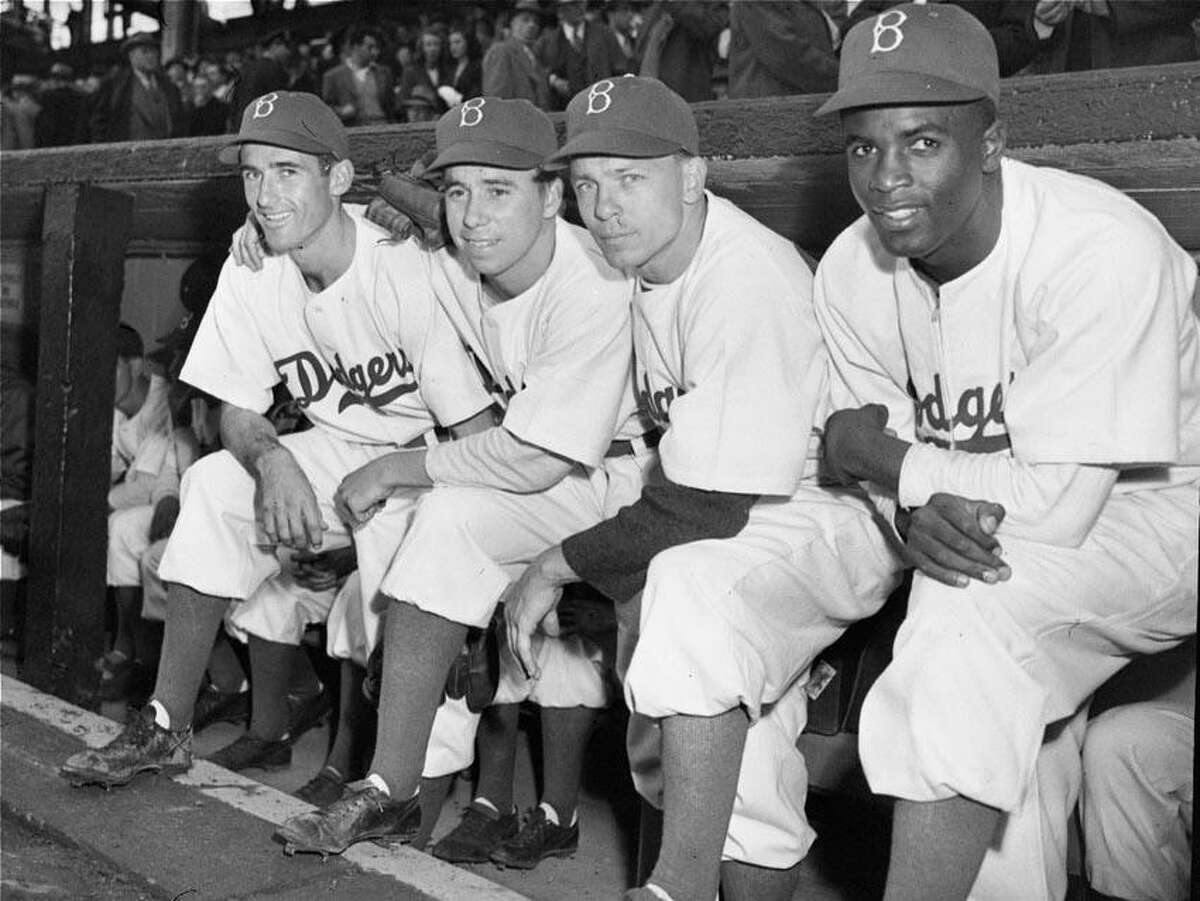 Third baseman John Jorgensen, left, purchased by the Brooklyn Dodgers from the Montreal Royals of the International League, joined the Dodgers on April 15, 1947 in time to start at third base in the season opener against Boston. The Dodgers starting infield, left to right, comprises Jorgensen, shortstop Pee Wee Reese, second baseman Ed Stanky, and first baseman Jackie Robinson, all of whom played in the opener at Ebbets Field, Brooklyn. (AP Photo)