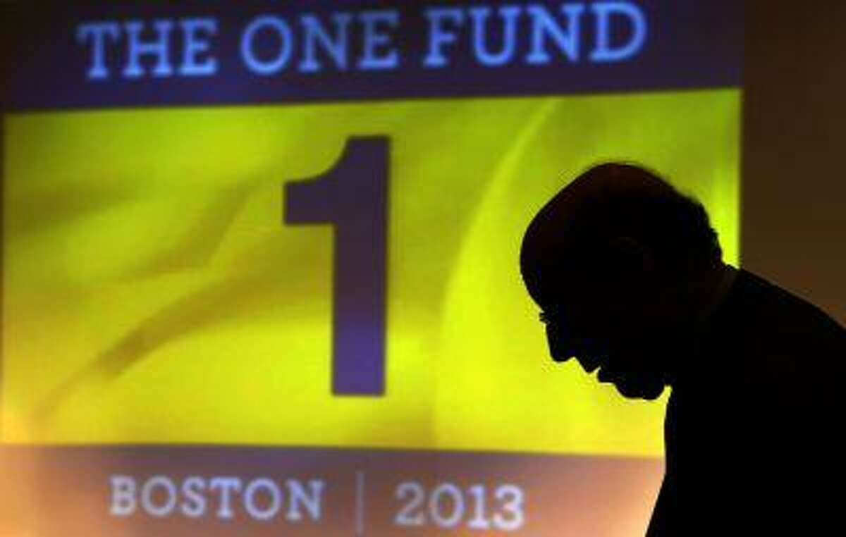 """Ken Feinberg, administrator for """"The One Fund, Boston"""" talks to a Boston Marathon bombing survivor before a town hall style meeting about the fund in Boston, Massachusetts May 7, 2013. """"The One Fund, Boston"""" is a fund for the victims of the Boston Marathon bombings. (Brian Snyder/Reuters)"""