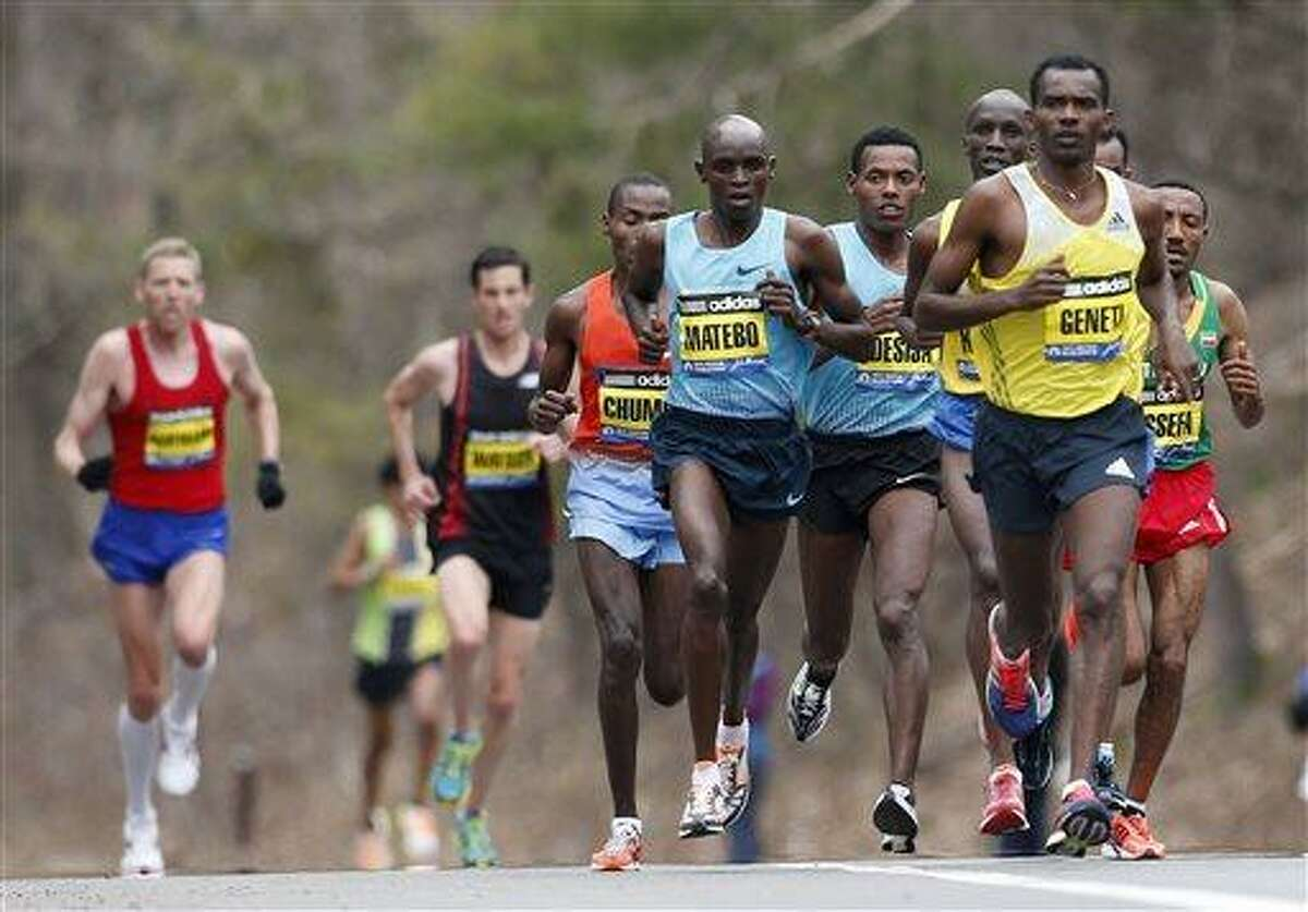 Elite mens marathoners including Levy Matebo, fourth from left, and Markos Geneti, front right, run in the 117th Boston Marathon in Wellesley, Mass., Monday, April 15, 2013. (AP Photo/Michael Dwyer)