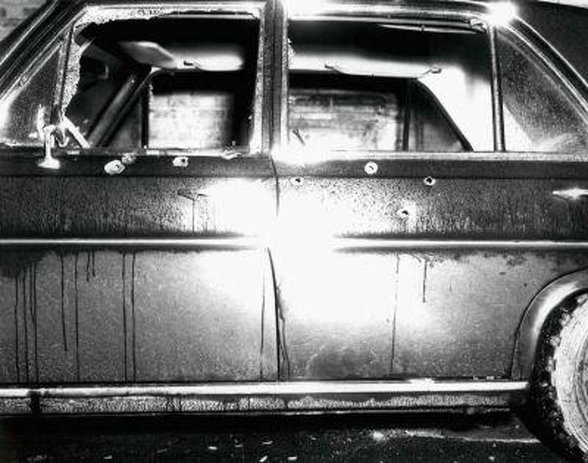 A vehicle with bullet holes and broken glass which was shown to jurors hearing the racketeering and murder trial of accused Boston mob boss James
