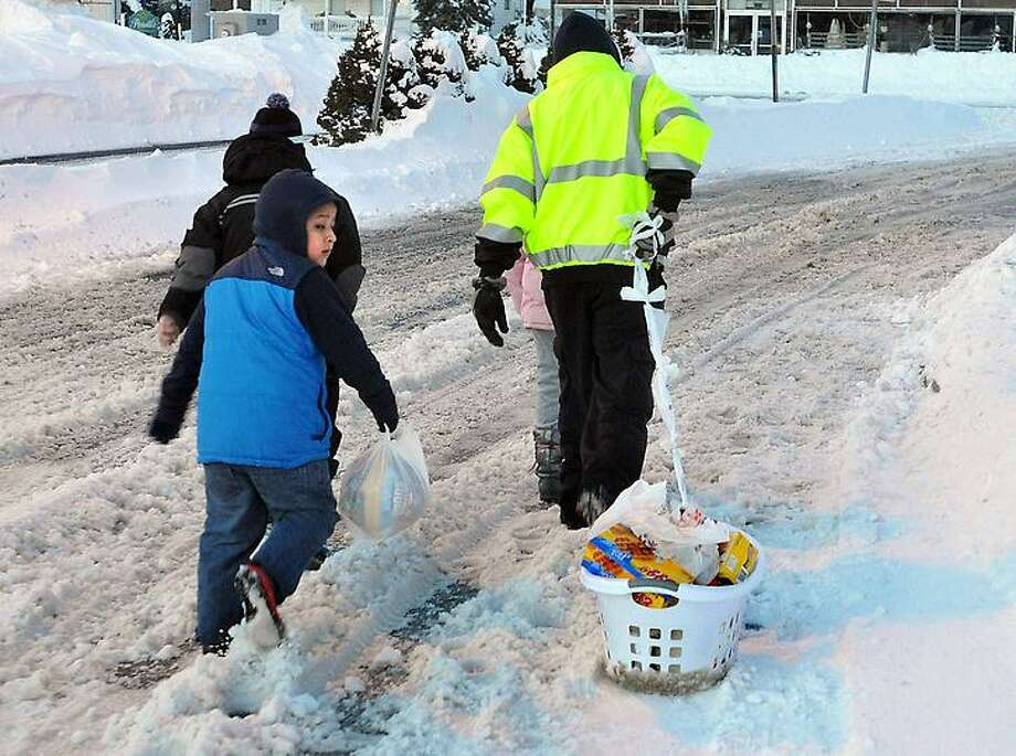 New Haven--A family leaves Stop & Shop in Amity, with their groceries in tow. The store was one of the only businesses open. Photo-Peter Casolino 2/9/13