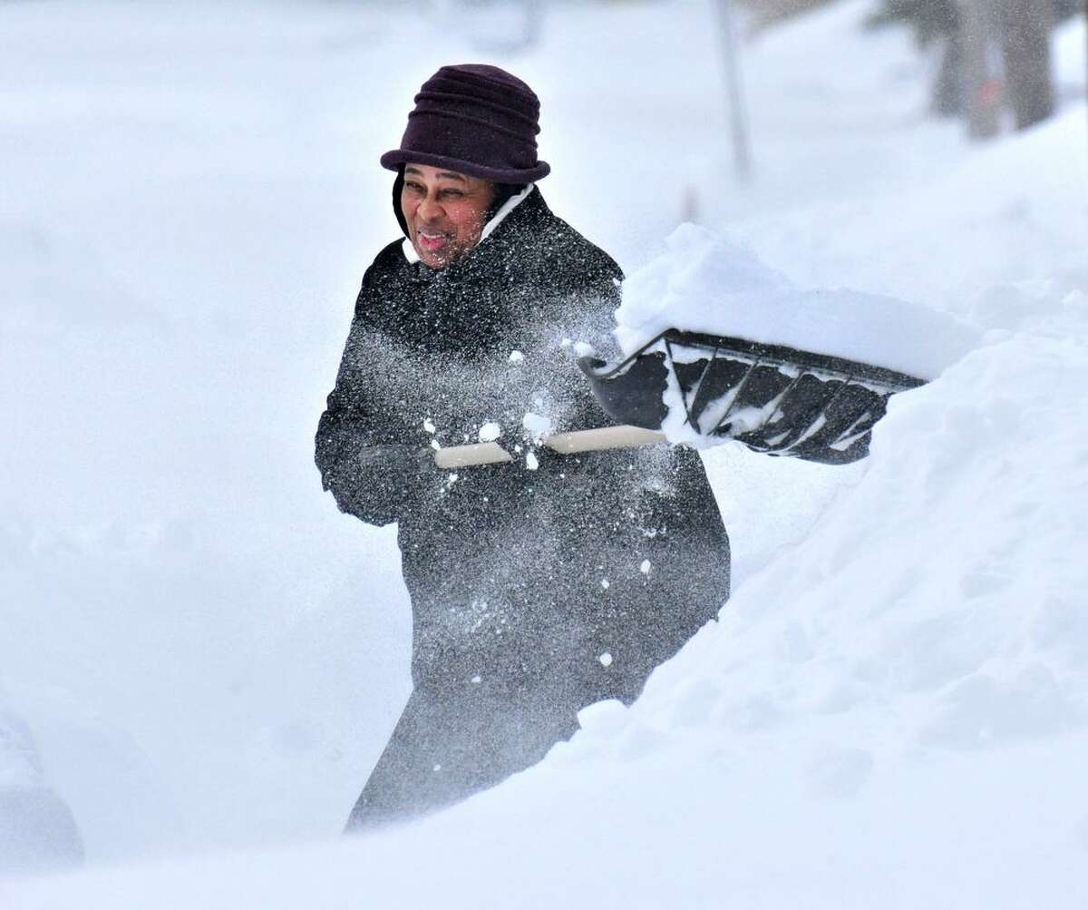 New Haven--Karen Bethea shovels out on Lowin Ave in New Haven. Photo-Peter Casolino 2/9/13
