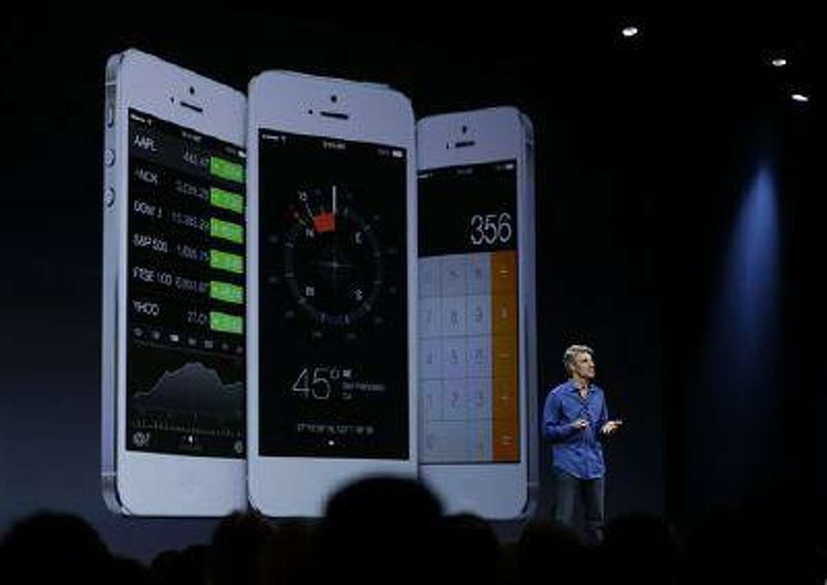 Craig Federighi, senior vice president of Software Engineering at Apple talks about the features of the new iOS 7 during the keynote address of the Apple Worldwide Developers Conference Monday, June 10, 2013 in San Francisco. (AP Photo/Eric Risberg)