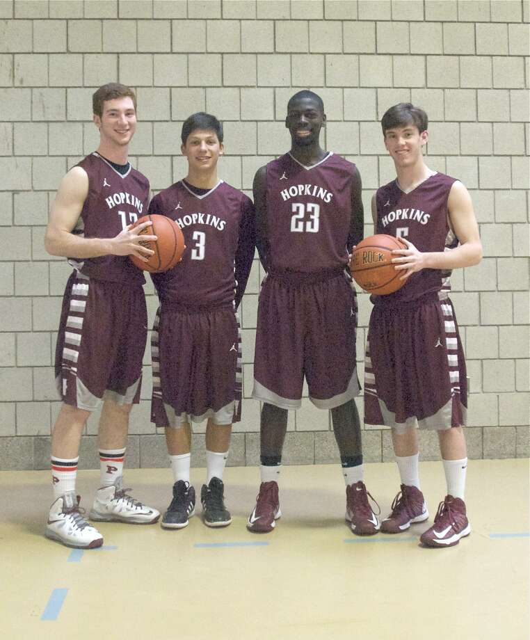 From left, Hopkins boys' basketball senior co-captains Paul Tupper, Sam Beck, Kahdeem Cohens and Tommy McGrath. (Photo by Mary Albl/Register)