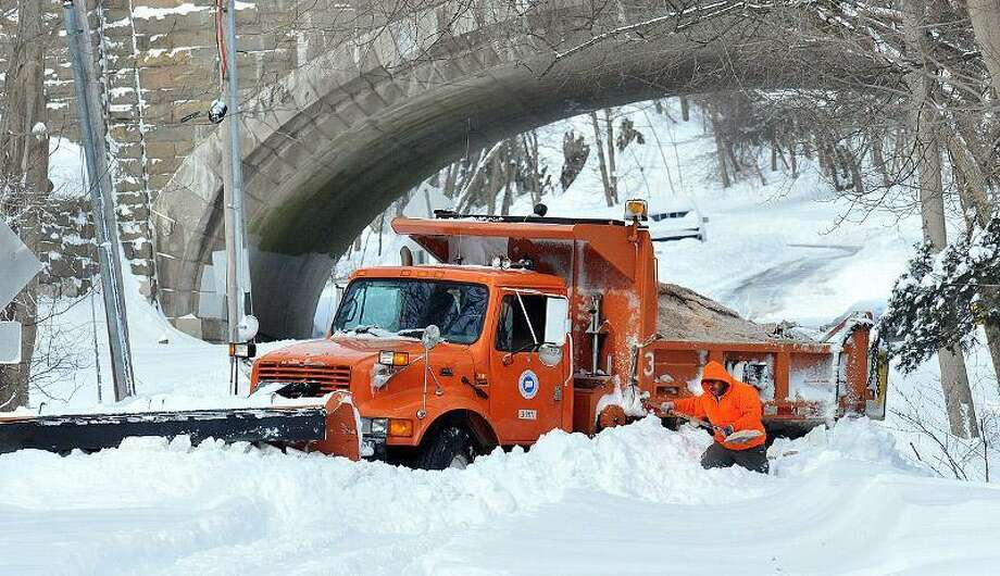 New Haven -- A state DOT driver makes his way Fountain Street after freeing his truck that was stuck for over an hour. The driver had to dig it out on his own. Photo-Peter Casolino 2/9/13