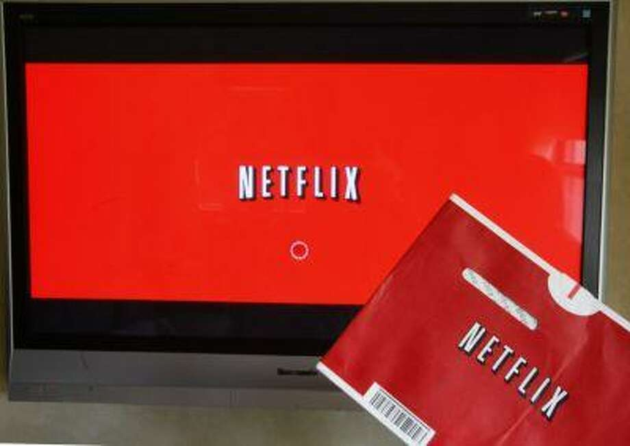 FILE - In this Oct. 1, 2011 file photo, a Netflix DVD envelope and Netflix on-screen television menu are shown in Surfside, Fla. Netflix is going to start running original television series from Dreamworks Animation, the company announced Monday, June 17, 2013. Financial terms were not disclosed. Netflix Inc. says the multi-year agreement is its biggest deal ever for original first-run content and includes more than 300 hours of new programming. It expands on an existing relationship between the companies. (AP Photo/Wilfredo Lee, File) Photo: AP / AP